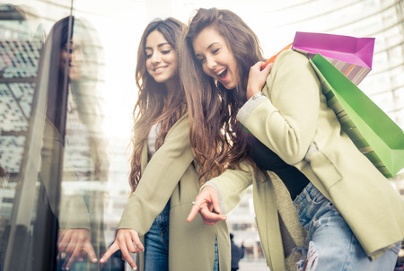 best friends girls: Two beautiful girls making shopping in the city center Stock Photo