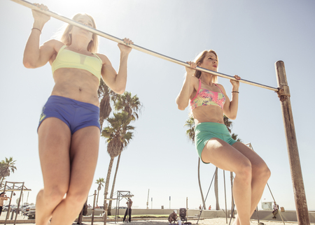 strong chin: Twin sisters training in Venice beach. Concept about people, sport and wellness Stock Photo