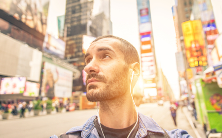 time square: Man walking in Time square. Looking up at the huge buildings Stock Photo