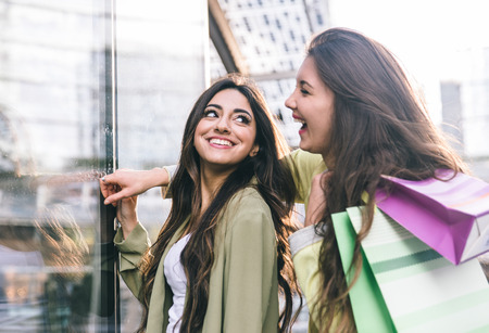 best friends: Crazy girls making shopping in the city center