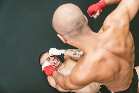arts: fighters fighting on the ground.