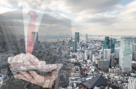 man in suite: Double exposure with businessman and city skyline. Man using tablet in an office. Stock Photo