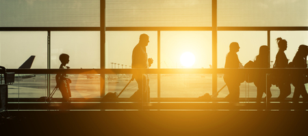 baggage: Passengers silhouettes at the airport. Stock Photo
