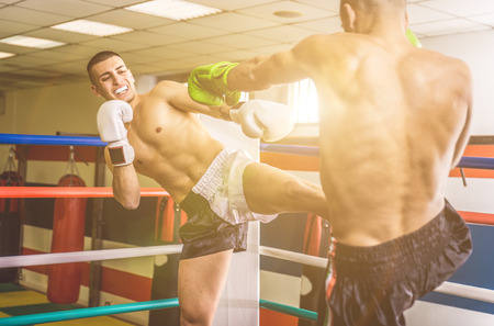 fighting arts: Fighters fighting on the ring. Kickboxing match in the gym.Concept about training and fighting Stock Photo