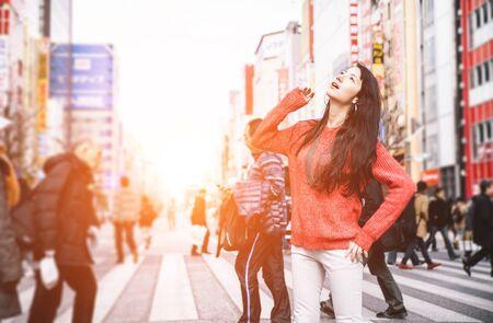 harajuku: Japanese girl in tokyo exploring the city. Young woman with casual clothes walking in Akihabara