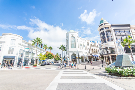 drives: BEVERLY HILLS, CA - OCTOBER 15, 2015: Rodeo Drive in Beverly Hills. Rodeo Drive is an affluent shopping district known for designer label and haute couture fashion.