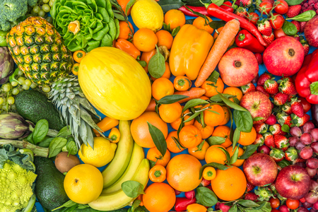 fruit background: Colorful mix of fruits and vegetables background - Assortment of fresh and natural food sorted by color