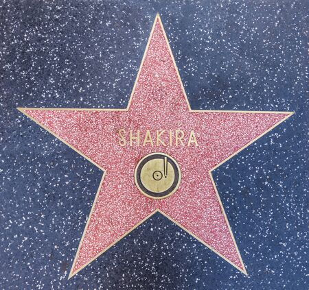 fame: LOS ANGELES, CA - OCTOBER 12, 2015: Columbian singer Shakiras star on Hollywood Boulevard where she was honored with the 2,454th star on the Hollywood Walk of Fame Editorial