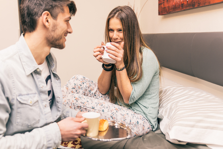 truelove: Lovely boyfriend bring some breakfast to his girlfriend in the morning. Romance and kindness in relationship. Concept about love and relationship