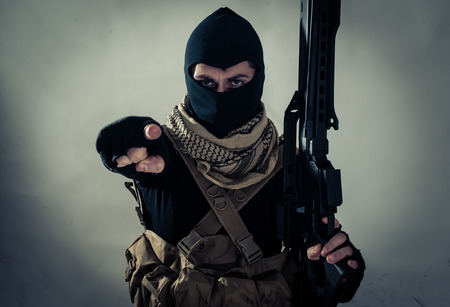 Terrorist menacing western countries on a tape. Concept about terrorism and hybrid warfare
