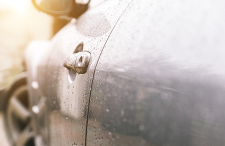 drift: Close up on a sport car door and rain drops Stock Photo
