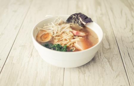 chinese noodle: Japanese ramen bowl on wood background. Tasty japanese food