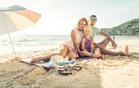 Happy family enjoying time on the beach. concept about family and vacations photo