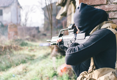 middle east crisis: Soldier fighting on the enemy land. concept about warfare and terrorism Stock Photo