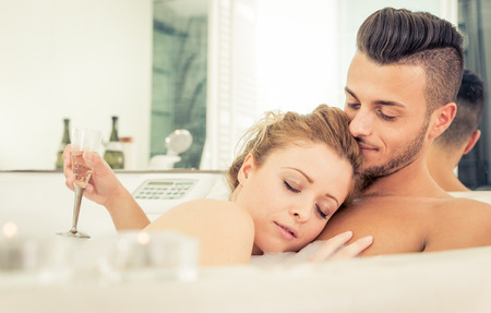 honey moon: Young happy successful couple enjoying an hot bath in the jacuzi