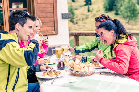pic nic: Group of friends eating in a typical restaurant - Hikers having meal on a daily excursion in the nature Stock Photo