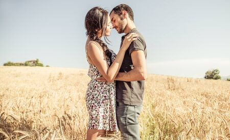 couple nature: Young couple kissing ina wheat field