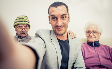 family memories: Family portrait with grandparents. selfie with smart phone Stock Photo