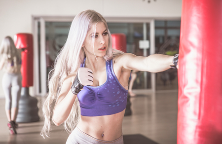modern fighter: Woman fighter hit the heavy boxing bag