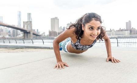 Woman making push up training in New york city