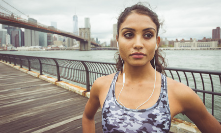 girl sport: Professional runner dramatic portrait. concept about sport and fitness in New york city