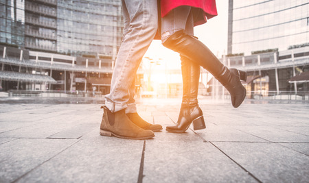 men s feet: Kiss in Milan. Couple kissing in an urban area. View from the floor with focus on the feet
