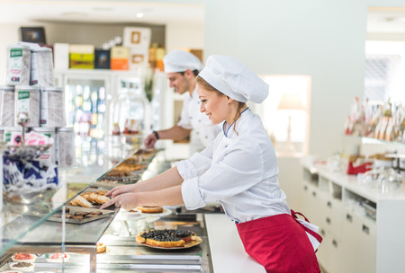 cakes and pastries: Pastry chefs working in a bar cafeteria