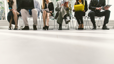 wait: Row of business people waiting for an interview. Concept about business and professions