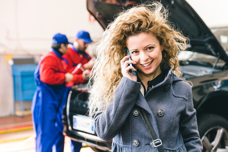 Woman calling car assistance service after car break down Stock Photo
