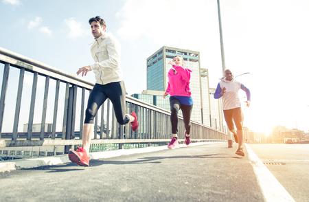 taking a break: Group of urban runners making sport in an urban area