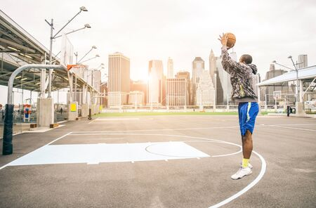 michael: Sportive afro-american man playing  basketball outdoors - Basketball player training on shooting