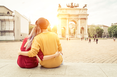 Romantic couple enjoying the sunset watching the monuments in the city center