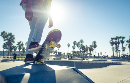 best practice: Skater boy ready to performing tricks at the skate park