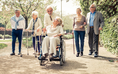 old people: Group of old people walking outdoor Stock Photo