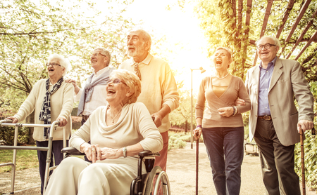 seniors laughing: Group of old people walking outdoor Stock Photo