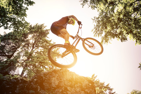 Extreme jump with a trial bycicle. concept about downhill and mountain bike