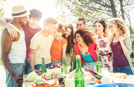 moods: Group of friends having fun at the house barbecue. Eating and sharing good moods