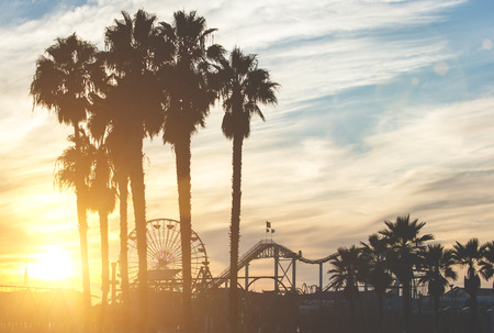 Santa monica pier with palm silhouettes Stock Photo