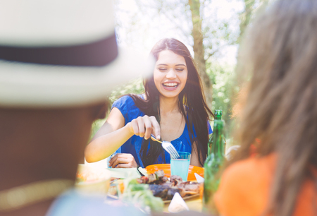 Group of mixed race friends making barbecue in the backyard and celebrate with good mood Stock Photo