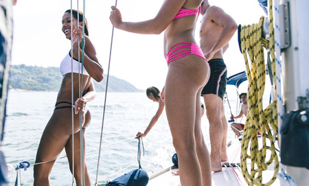 boat party: Friends having fun on the boat, making shower after diving in the sea Stock Photo