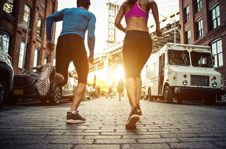 Couple running in Brooklyin. Urban runners on the move in New york Stok Fotoğraf - 64360925