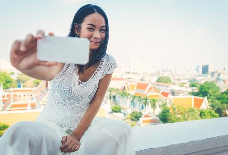 the enchantress: Thai woman taking selfie Stock Photo
