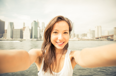carefree: woman taking selfie in New york