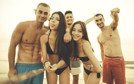summertime: Friends taking selfie on the beach Stock Photo