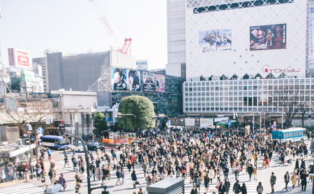 hectic life: Tokyo, Shibuya. February 11, 2015. The shibuya district in Tokyo. Shibuya is popular district in Tokyo, for his pedestrian cross where all pedestrians cross in the same moment from all direction