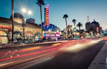 fame: LOS ANGELES - OCTOBER 16, 2015: View of Hollywood Boulevard by night. In 1958, the Hollywood Walk of Fame was created on this street as a tribute to artists working in the entertainment industry.