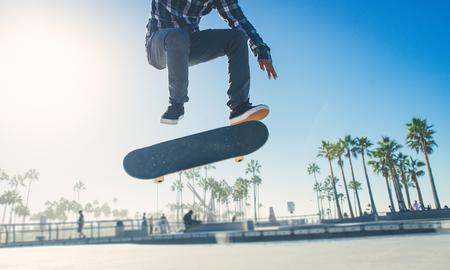 Skater boy practicing at the skate park Stock Photo