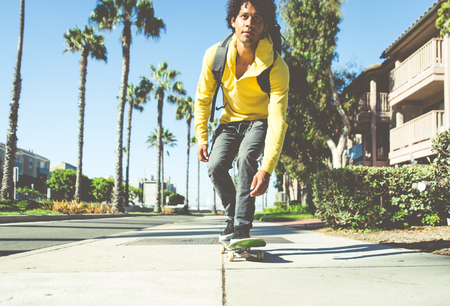 skateboarding tricks: Skater boy on the street in Los angeles. Skateboarding in venice, California Stock Photo
