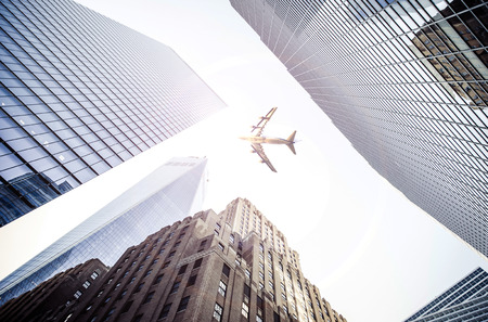 Plane flying over the city