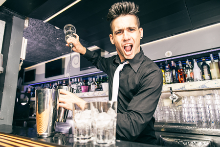 flair: Flair bartender at work in a night club - Barman mixing some cocktail in a bar Stock Photo